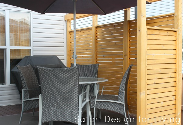 Replace the railing on your deck with a cedar privacy partition.