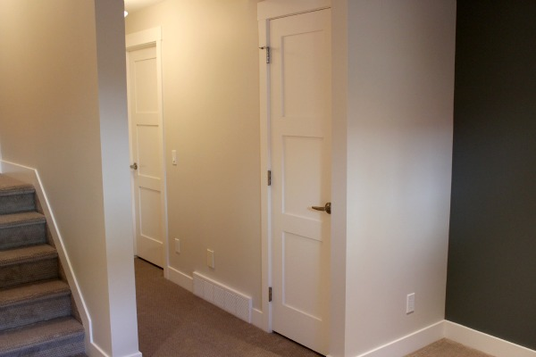 Basement Ideas - Basement Closet Addition with White Painted Shaker Style Door