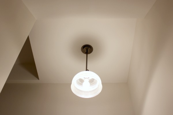 Basement Stairwell with Antique Nickel Archie Pendant by Progress Lighting - Prism Glass Pendant