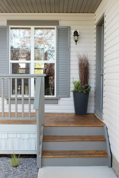 Front Porch Makeover with Grey Shutters and Benjamin Moore Wrought Iron Door - Satori Design for Living