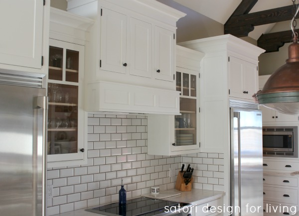 Classic Kitchen with White Painted Cabinets, Subway Tile & Copper Pendants