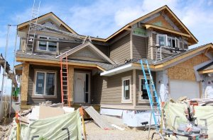 Exterior Home Under Construction - Client Project Update - Satori Design for Living