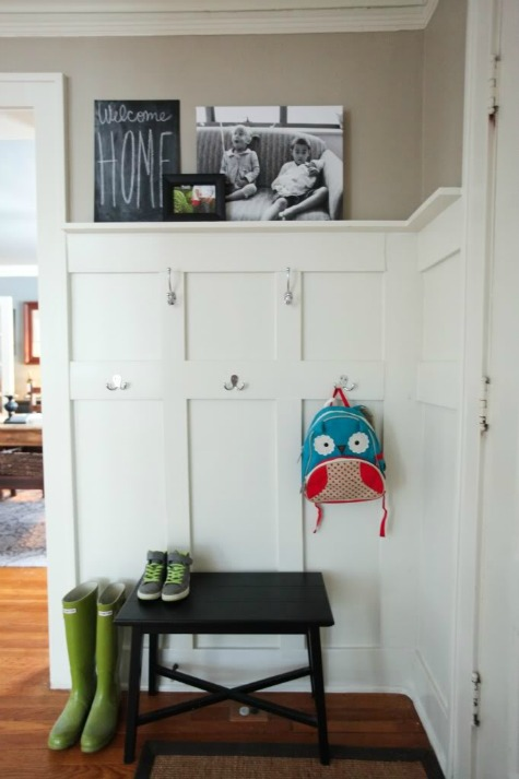 White Painted Paneling With Hooks in Entryway - Hello from the Natos