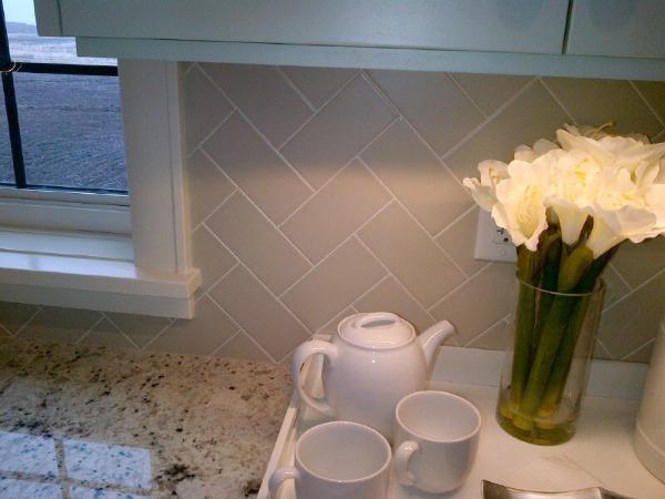 Showhome Tour - Grey Herringbone Subway Tile Backsplash Kitchen