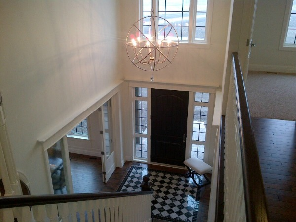 Showhome Tour - White Stairwell and Foyer - Orb Light Fixture
