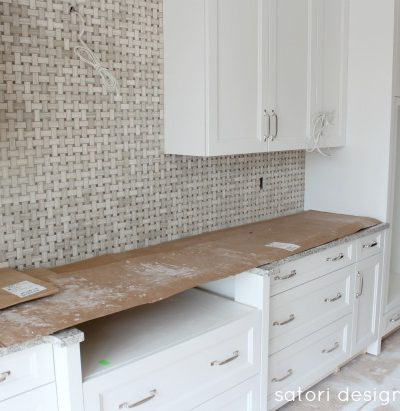 White Kitchen with Marble Backsplash Construciton