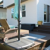 Cordovan Brown Stained Deck with Wicker Lounge Chairs