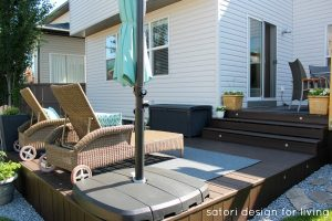 Backyard Updates - Behr Cordovan Brown Stained Deck with Wicker Lounge Chairs - Satori Design for Living