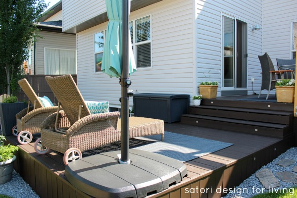 Backyard Updates- Cordovan Brown Stained Deck with Wicker Lounge Chairs