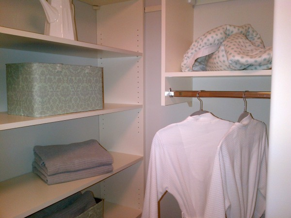 Functional Laundry Room with Storage plus hanging bar