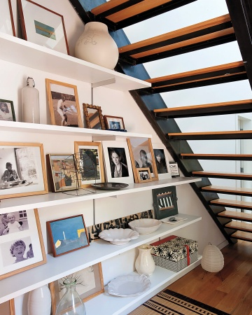 art collection under staircase - Remodelista