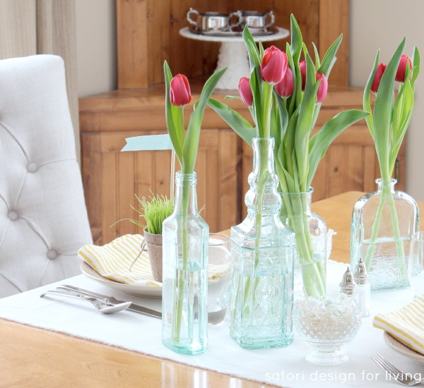 Nature Inspired Easter Table Setting - Tulips in green glass bottles and vases - Satori Design for Living