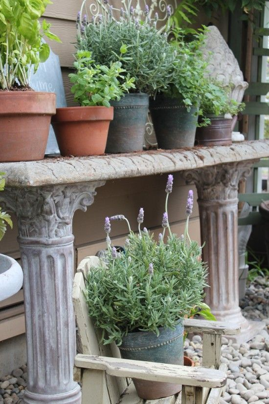 Potted Herb Garden Ideas diy stacked herb garden Herb Garden In Pots Stone Potting Bench The Inspired Room
