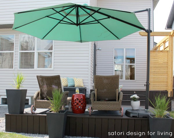 Outdoor Living Space with Oversized Aqua Offset Umbrella | Satori Design for Living