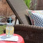 Outdoor Living Space with Wicker Chaise Lounge and Red Garden Stool | Satori Design for Living