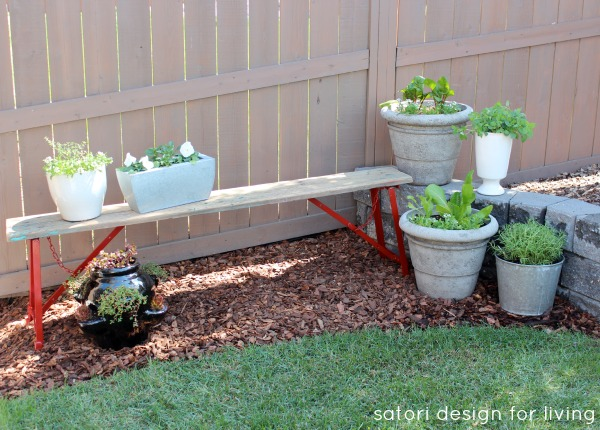 Weathered Red Bench with a Vegetable, Herb and Flower Garden