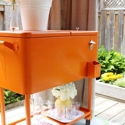 Outdoor Decorating Ideas - Orange cooler drink cart makeover for outdoor entertaining - Pink Little Notebook