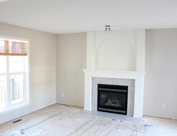 Benjamin Moore Baby Fawn OC-15 Living Room Paint Color with White Dove Trim and Fireplace