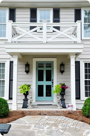 Benjamin Moore Grenada Villa Front Door Paint Color - via Dixie Delights