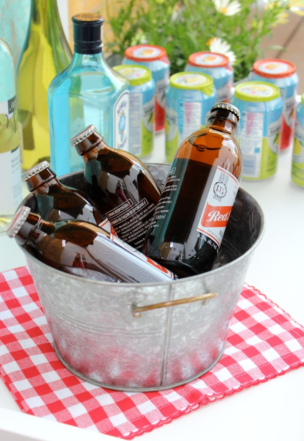 Tips for Stocking a Bar Cart - Galvanized Bucket of Ice Cold Beer - Satori Design for Living