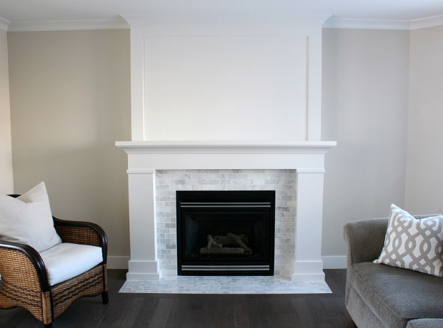 Our fireplace makeover is officially done! Come check out how we used inexpensive trim