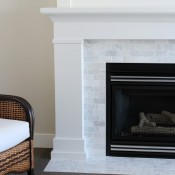 White and Marble Fireplace Makeover Details - White Painted Mantel with Marble Subway Tile Surround - SatoriDesignforLiving.com