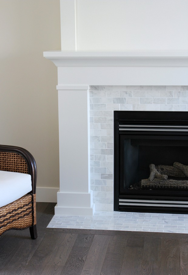 White and Marble Fireplace Makeover Details - White Painted Mantel with Marble Subway Tile - SatoriDesignforLiving.com