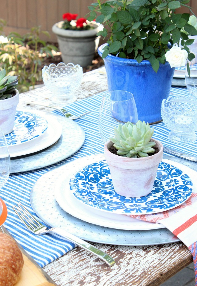 Flea market style outdoor table setting satori design for Patio table centerpiece ideas