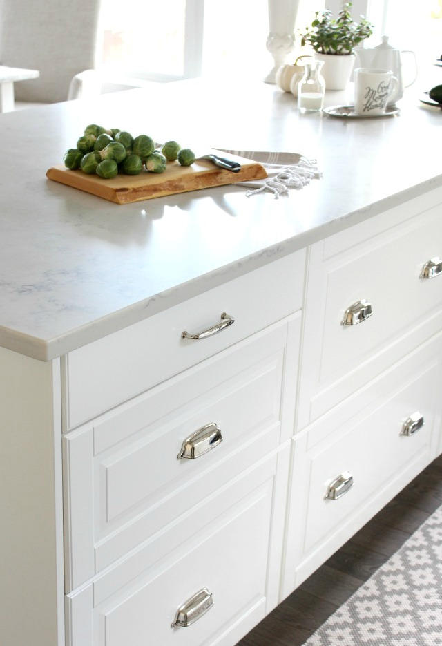 IKEA White Kitchen Island with Polished Nickel Cup Pulls and TCE 4005 Marble Quartz Countertop