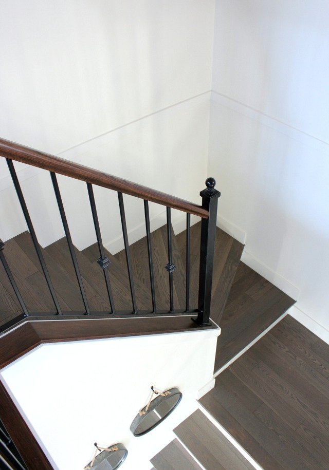 Installing Hardwood Stairs with Iron Railings - Satori Design for Living