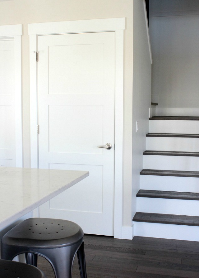 Dark Hardwood Stairs with White Painted Risers - Shaker Style White Doors in Kitchen - Satori Design for Living