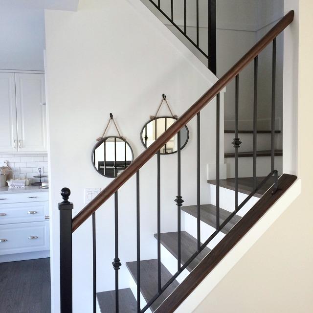 Stairs Makeover - Dark Hardwood Treads with White Risers - Iron Railings