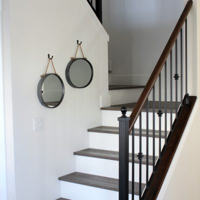 Want to transform your stairs from dingy carpet to beautiful hardwood? Come check out our staircase makeover with white risers and dark treads.