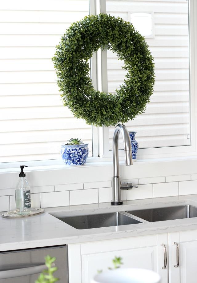 Classic White Kitchen with Subway Tile Backsplash and Gooseneck Faucet