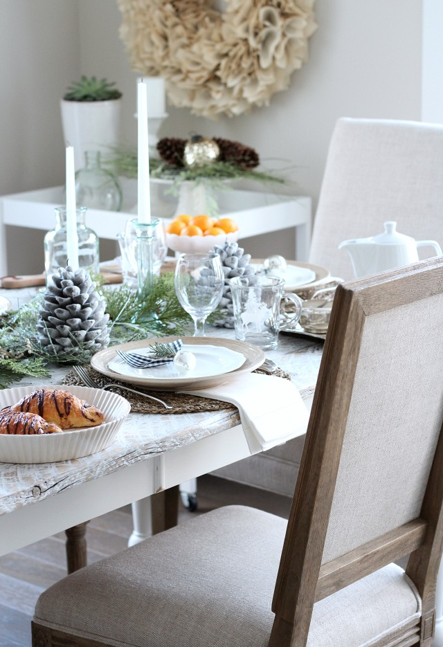 Holiday Decor - Christmas Dining Room Decorated with Greenery, Pine Cone Candles and DIY Book Page Wreath