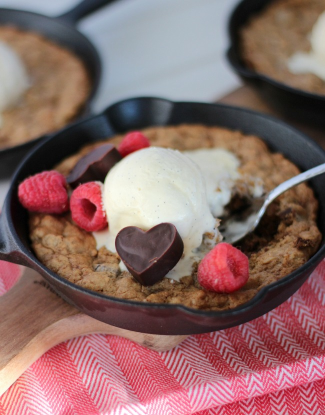 Valentine's Day Dessert - Oatmeal Chocolate Chunk Skillet Cookie Topped with Vanilla Ice Cream and Heart Shaped Chocolate Truffles