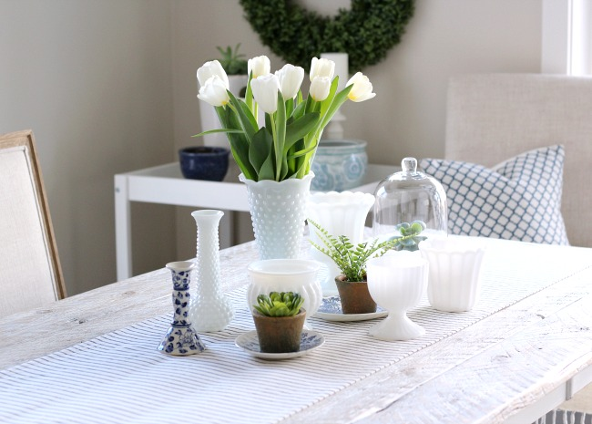 Fresh Spring Table Centerpiece Using Tulips, Thrift Shop Milkglass, Greenery and More