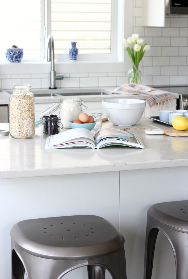 Spring Kitchen Decorating Ideas - White IKEA kitchen Island with Marble Quartz Countertop for Baking
