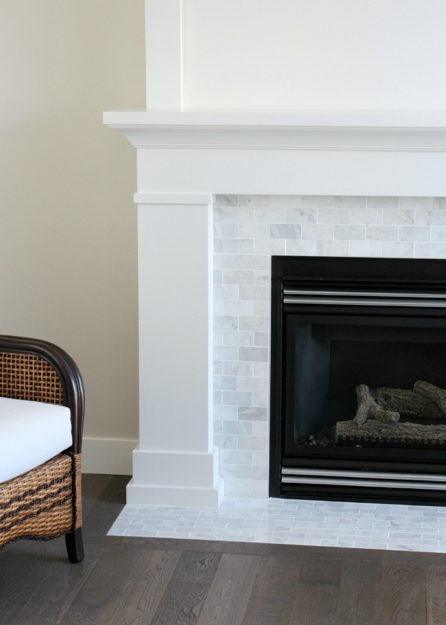 Fireplace with White Painted MDF Mantel and Marble Subway Tile Surround - Satori Design for Living