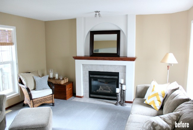 Living Room BEFORE with Arched Fireplace and Red Oak Trim