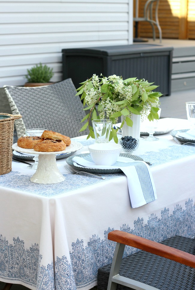 Casual Outdoor Brunch Tablescape Ideas with Blue and White Decor and Tree Blossom Arrangement in Milk Glass Vase - Satori Design for Living