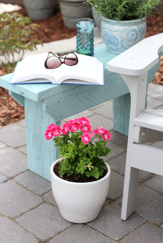 I love this distressed wood outdoor side table painted in a fresh aqua blue color!