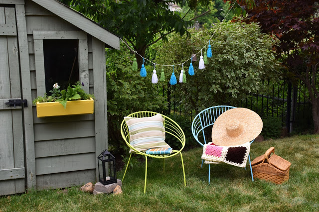 Beautiful Outdoor Living Spaces - Whimsical Backyard with Yellow Flower Boxes by Woman in Real Life