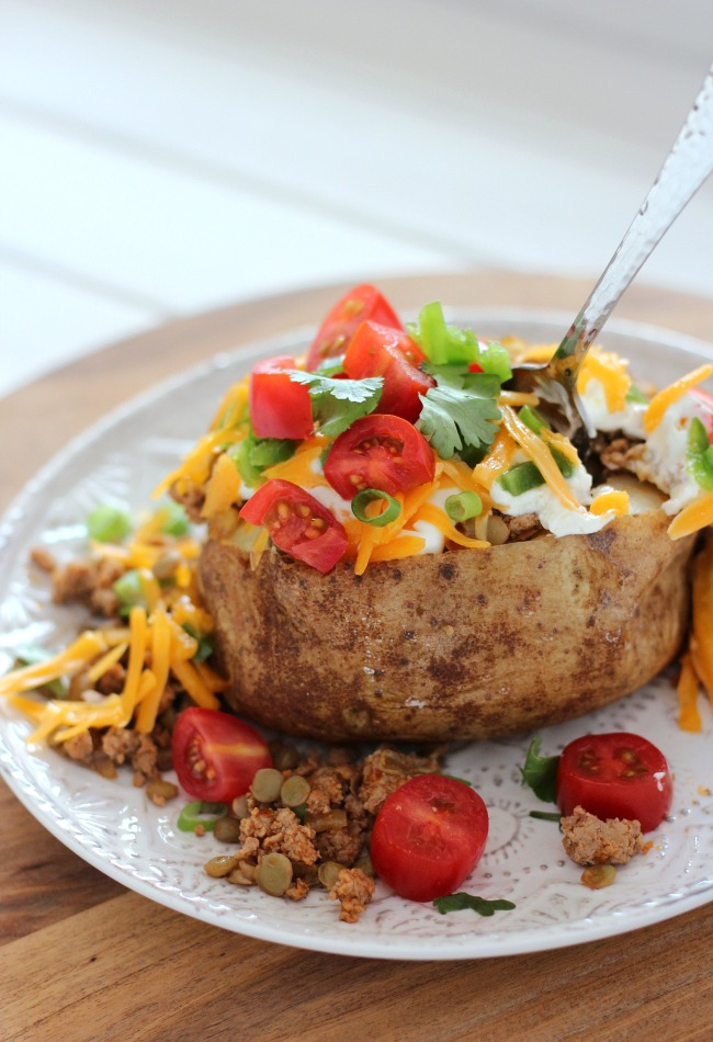 These baked potatoes loaded with ground turkey, lentils and your favourite tex mex toppings are protein-packed and delicious!