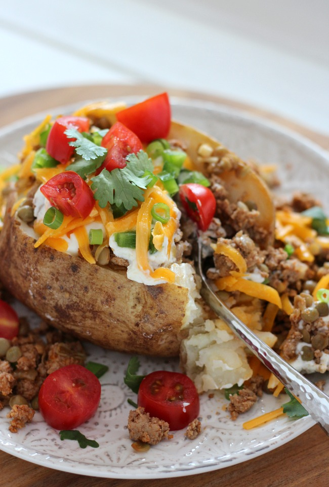 These tex mex loaded baked potatoes with turkey and lentils taste delicious and pack a nutritional punch. Your family will love them!