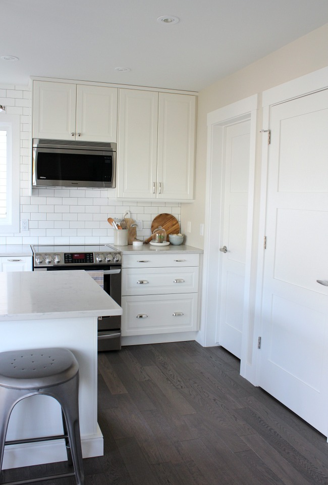 White Craftsman Style Trim and Doors in the Kitchen - White Classic Kitchen Design - Satori Design for Living