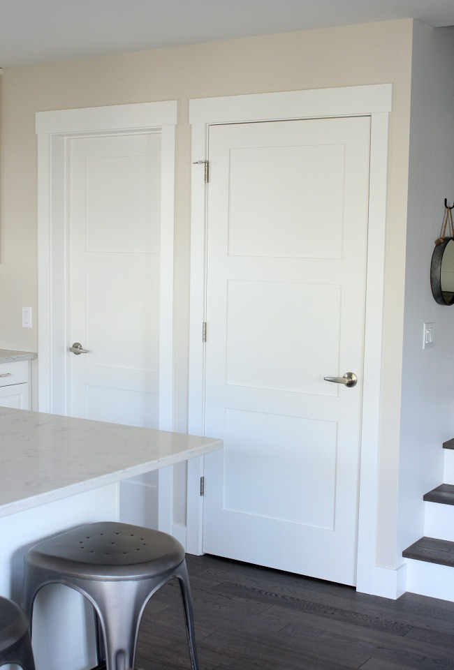 White 3 Panel Shaker Style Doors in the Kitchen - Craftsman Trim - Satori Design for Living