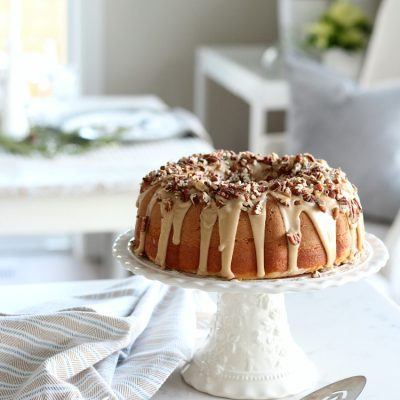 This Caramel Pecan Bundt Cake is a holiday dessert your family and friends will love. Totally scrumptious with its gooey caramel and toasted pecan topping. Easier to make than it looks!