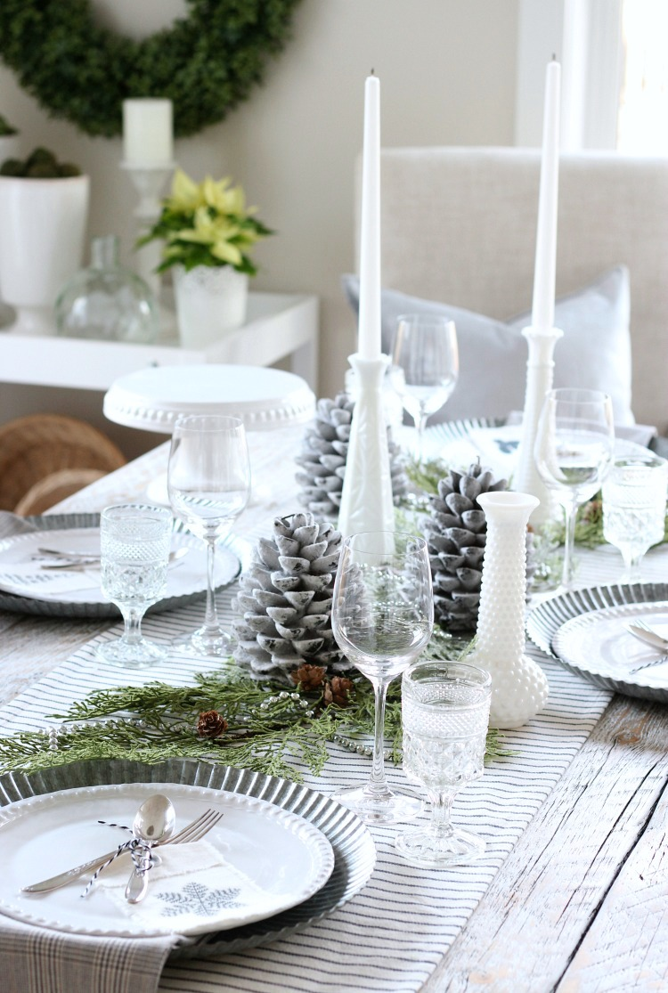 Christmas Home Tour - White Table Setting with Greenery and Pine Cone Centerpiece - Satori Design for Living