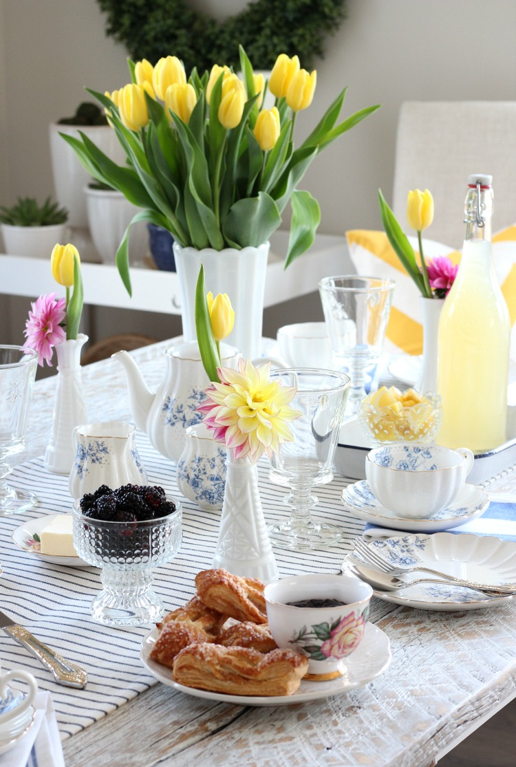 Tea Party Ideas - Bright and Cheery Tablescape with Yellow Tulips, Floral Tea Cups and Pastries